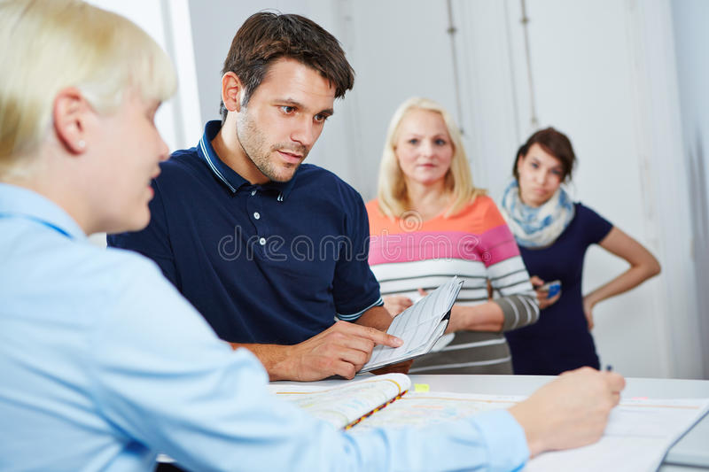 Man Scheduling Appointment With Doctors Assistant Royalty Free Stock Image