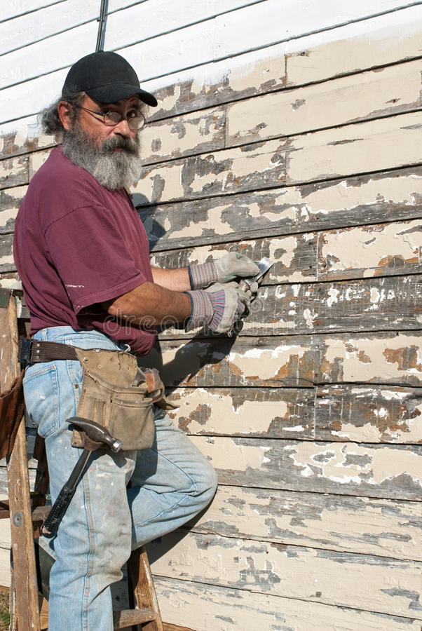 Free Man Scraping Paint Stock Image - 19334701