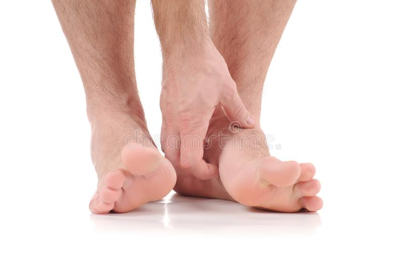 Man scratch the itch with hand. Infection of the feet caused by fungus. Man scratch the itch with hand. Foot itching, infection of the feet caused by fungus stock images