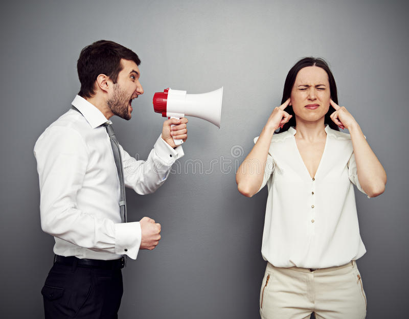 Download Man Screaming In Megaphone At The Woman Stock Photo - Image: 30425150