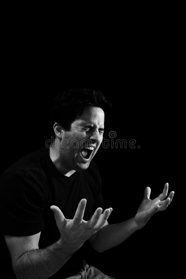 Anguish. A man screams out in anguish royalty free stock photography