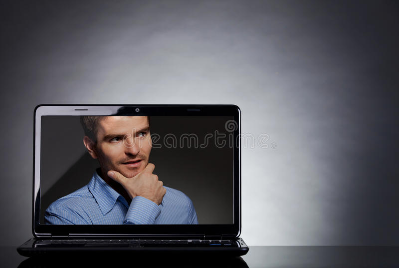 Man on the screen of a laptop stock photography