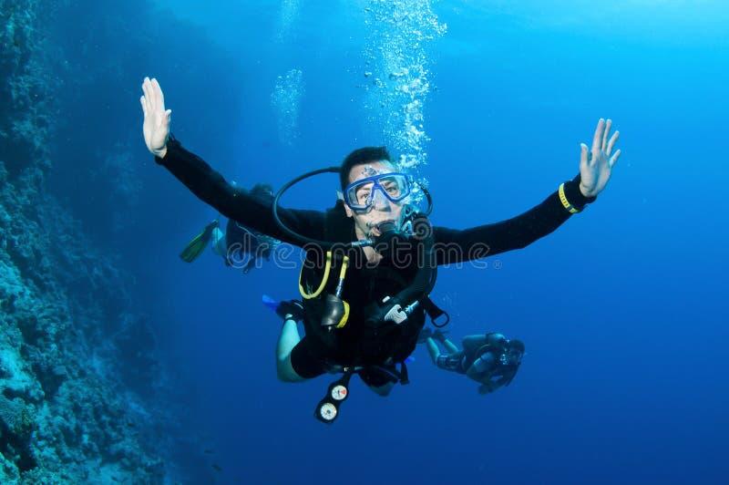 Man scuba diver stock photo