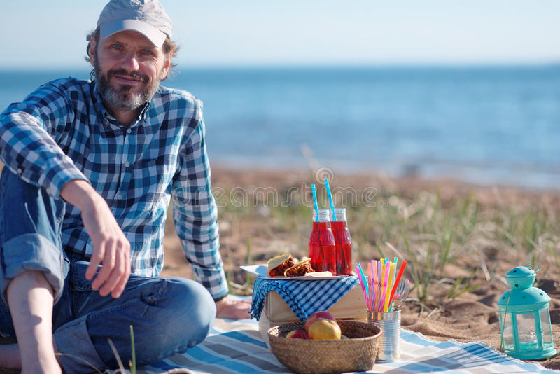 Man during sea picnic royalty free stock photos