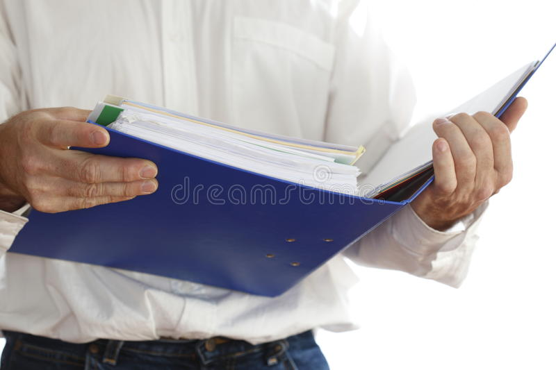 Man is searching. A man is searching in document folder stock images