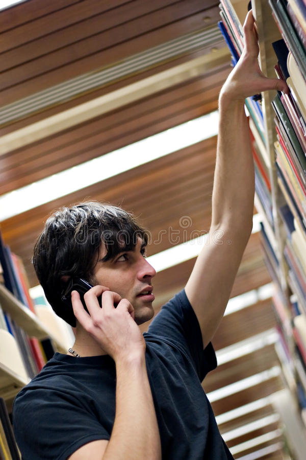 Download Man Searching At The Library Royalty Free Stock Images - Image: 13618459