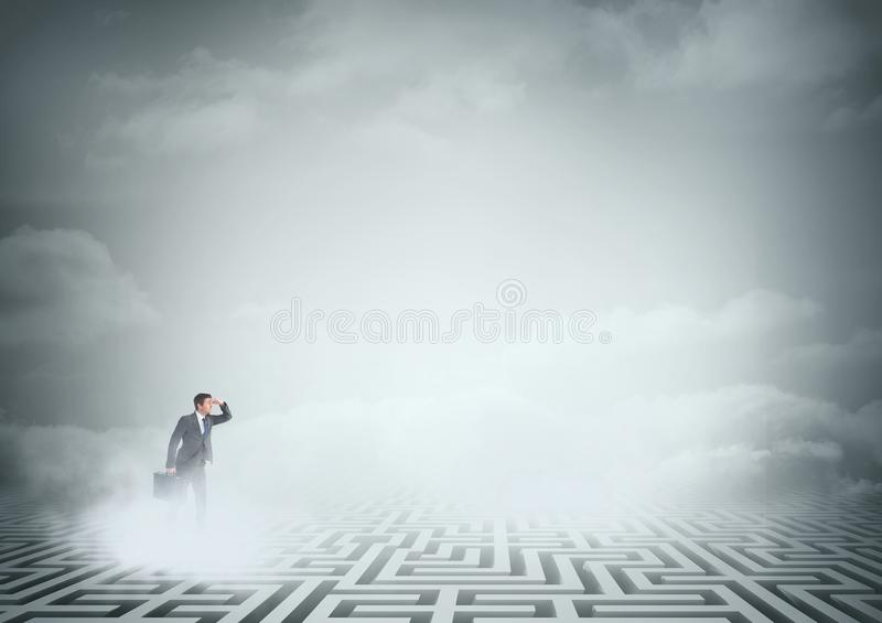 Man searching on a maze with clouds royalty free stock photography