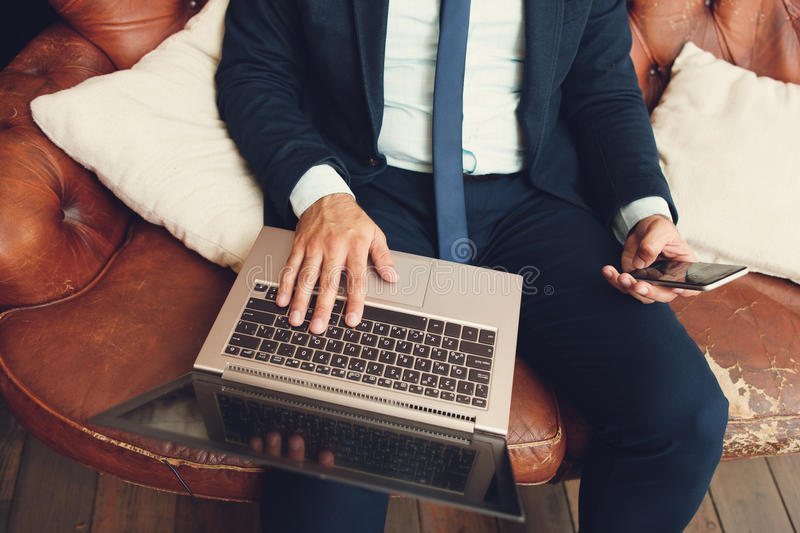 Man searching for new job with laptop stock images