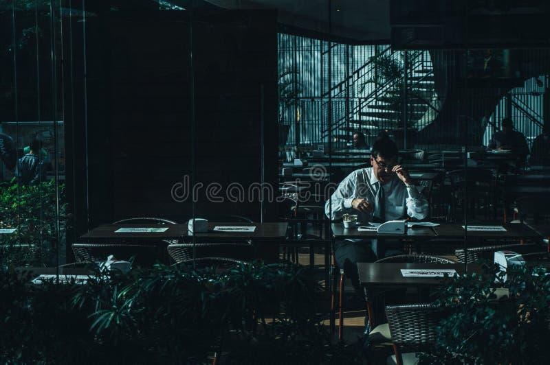 Man Seating Beside Desk Near Door royalty free stock photos