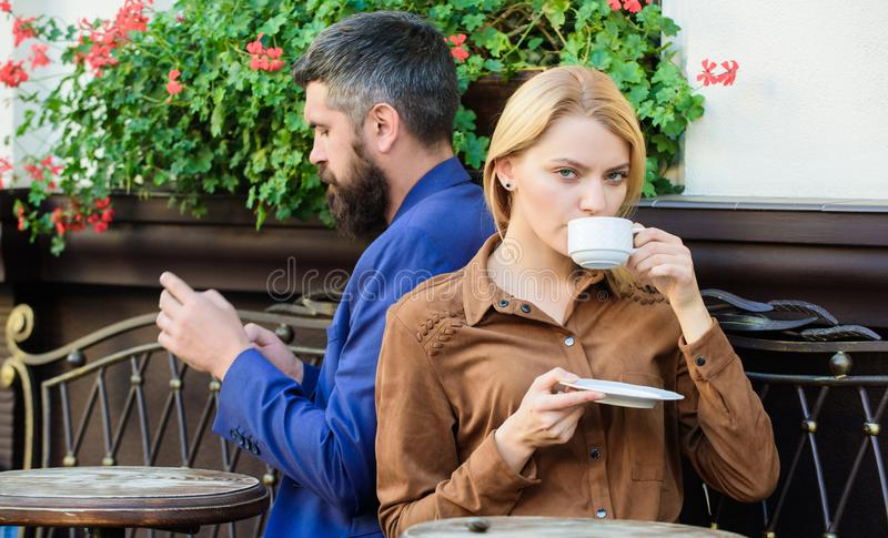 Man secret messaging cheating on wife. Cheat and betrayal. Family weekend. Married lovely couple relaxing together. Couple cafe terrace drink coffee. Couple in royalty free stock images