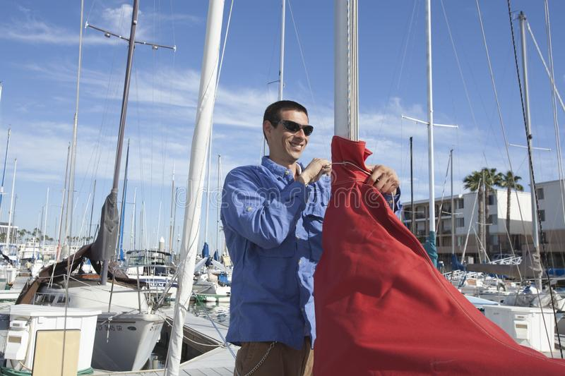 Download Man Securing Sail Of Boat stock image. Image of nautical - 29666439