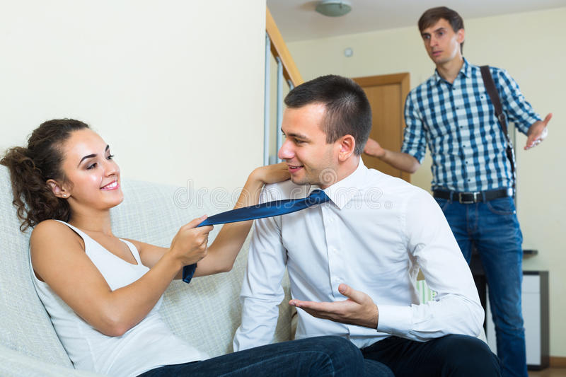 Man seeing girlfriend cheating on him royalty free stock photo