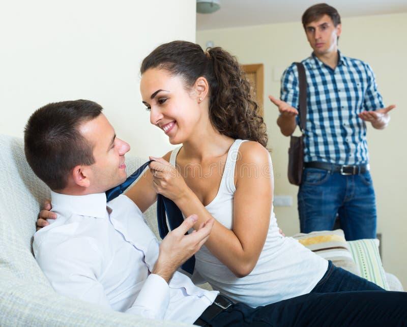 Man Seeing Girlfriend Cheating On Him Stock Image - Image