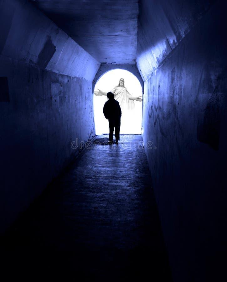 Man Seeking Jesus in Dark Tunnel. Man in dark tunnel seeking the light of Jesus royalty free stock image
