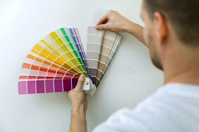 Man selecting paint color from swatch royalty free stock photography