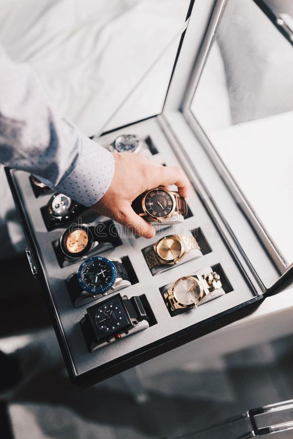 Man selecting wristwatch stock images