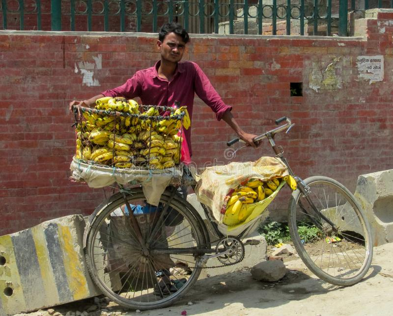Man sell bananas with the bicycle in Nepal royalty free stock photography