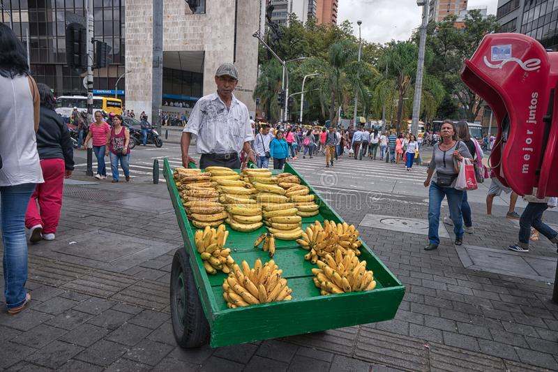 Man selling bananas in Medellin Colombia stock photos
