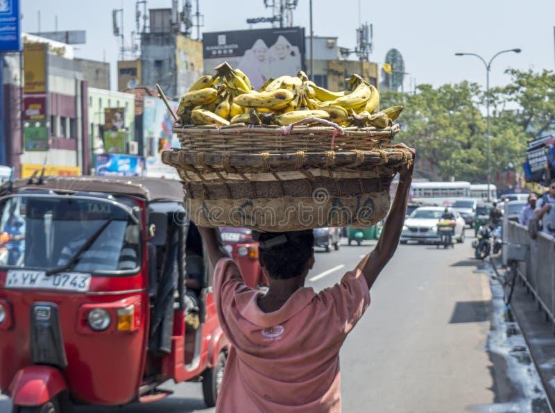 Man selling bananas on the street in Sri Lanka stock image