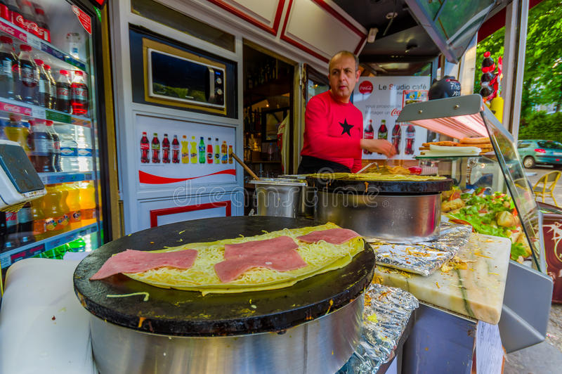 Man selling crepes in a kiosk, Paris, France royalty free stock image