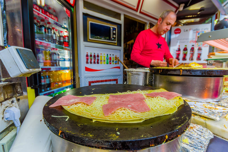 Man selling crepes in a kiosk, Paris, France stock image