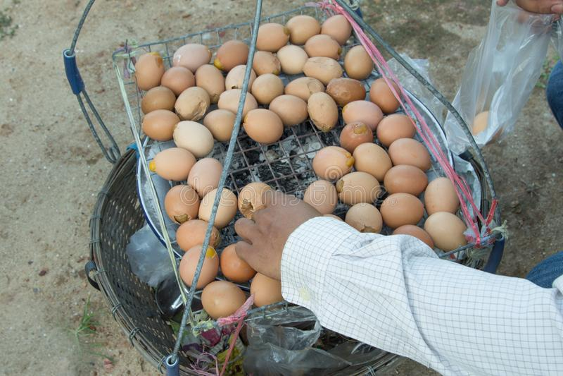The man is selling eggs. The man is selling eggs in the beach stock photos