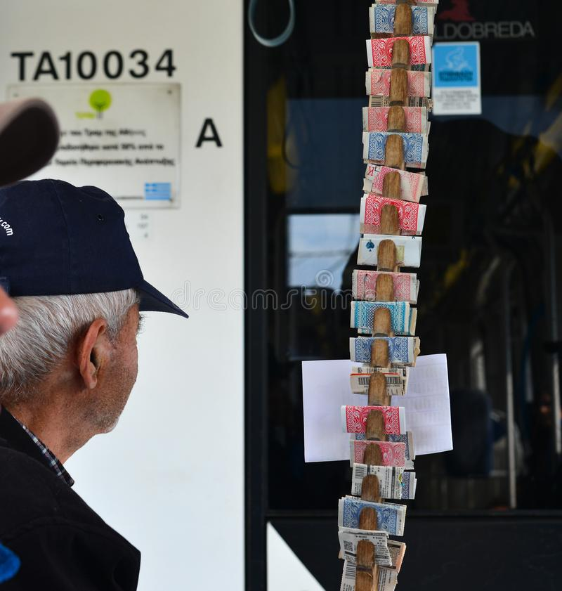 Man selling lottery tickets on street. Athens, Greece - Oct 11, 2018. Selling lottery tickets on street in Athens, Greece. Athens is a global city and one of the royalty free stock images