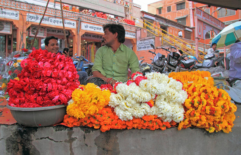 Man is selling petals of flowers in Jaipur, India royalty free stock photo