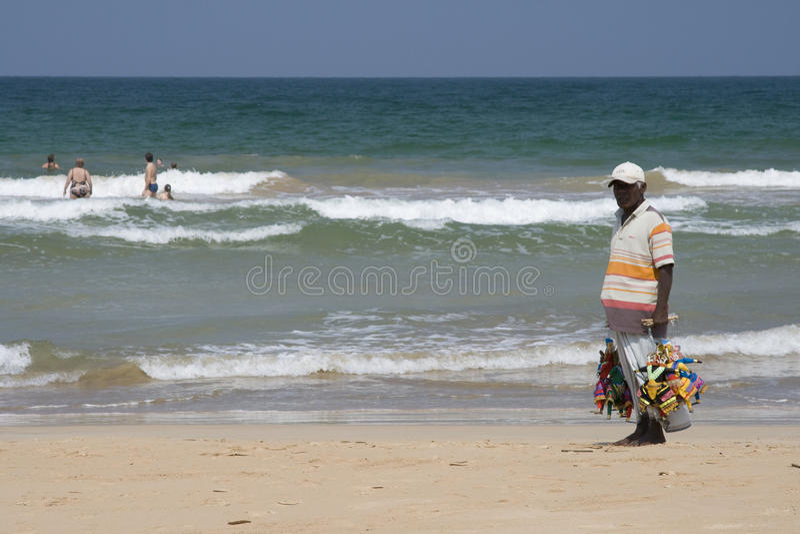 Download Man Selling Souvenirs On Bentota Beach, Sri Lanka Editorial Stock Image - Image: 19376639