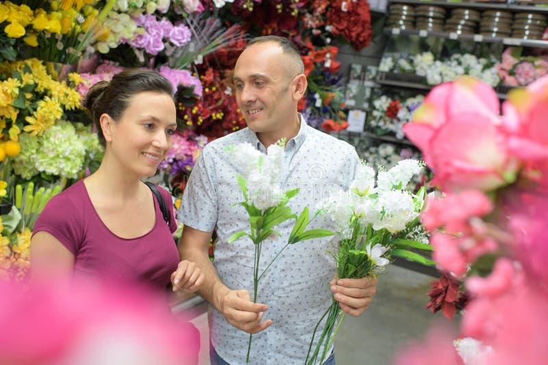 Man sells flowers in flower shop