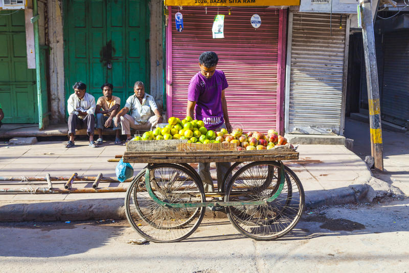 Man sells fruits at the vegetable royalty free stock images