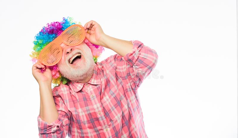 Man senior bearded cheerful person wear colorful wig and sunglasses. Having fun. Funny lifestyle. Fun and entertainment stock photo