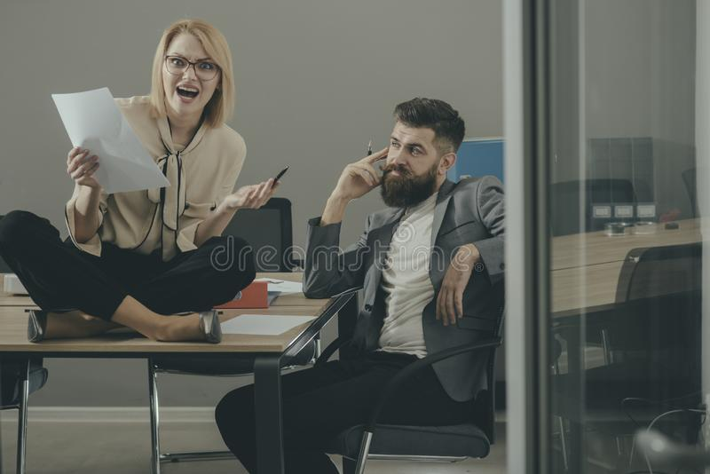 Man and sensual girl work together in office. Man and woman write business plan, collaboration for success. Man and sensual girl work together in office. Man and royalty free stock photos