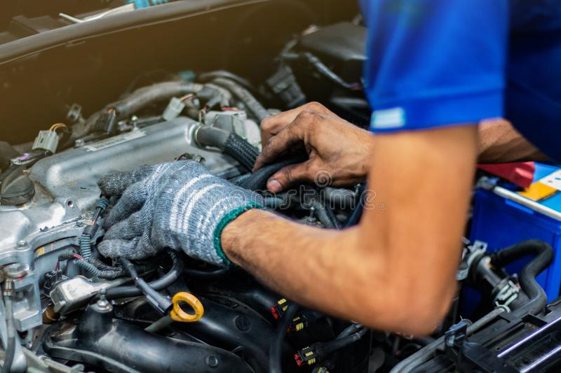 Man service checking the car engine stock photo