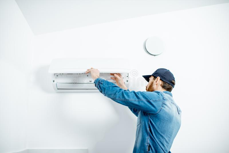 Man serving the air conditioner stock photos