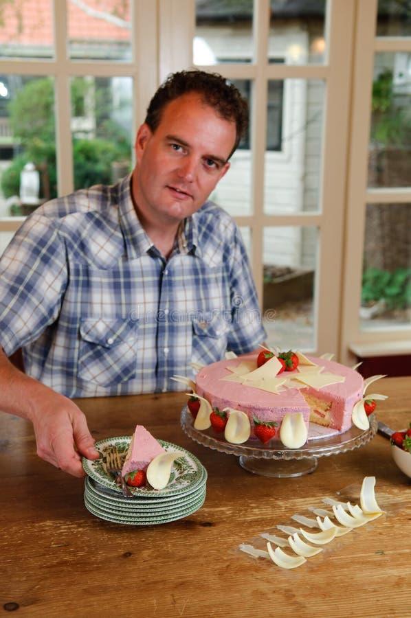 Man serving cake in kitchen stock photos