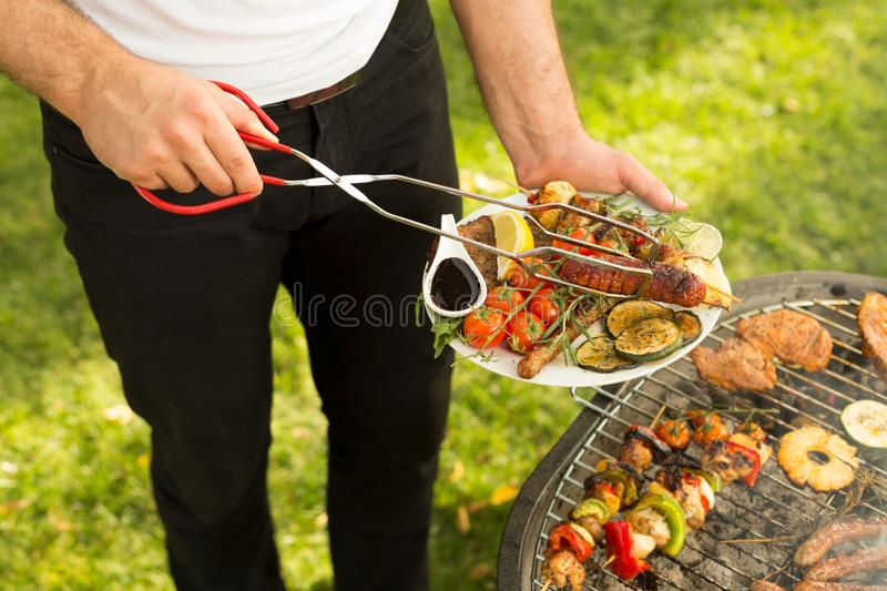 Man serving delicious grilled meal royalty free stock images