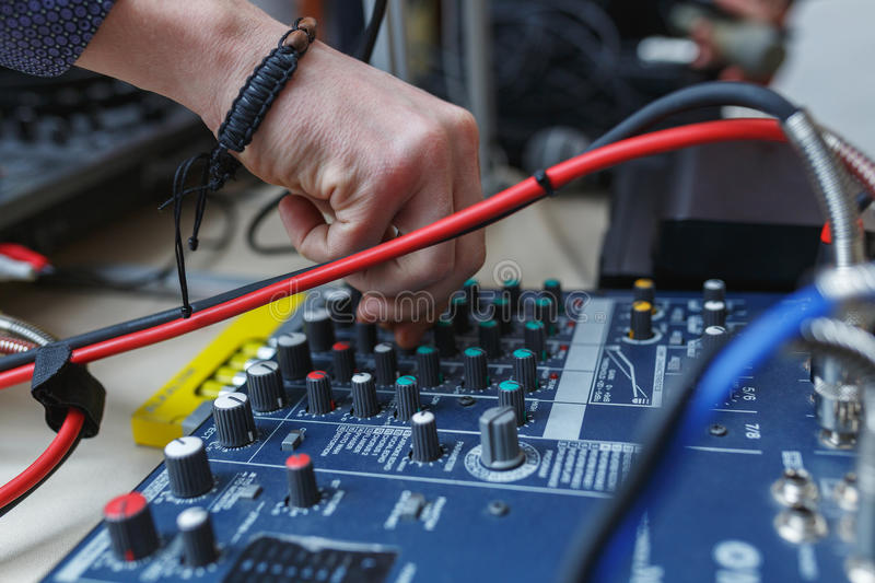 Download Man Sets The Audio Level On The Console Audio Effects. Stock Image - Image: 83711603