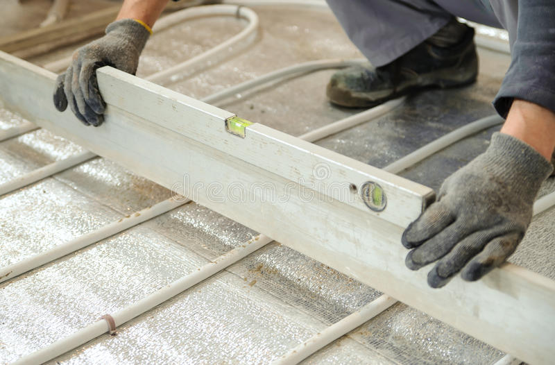 Man Sets Level Concrete Floor Stock Photo - Image of pipe, industry ...