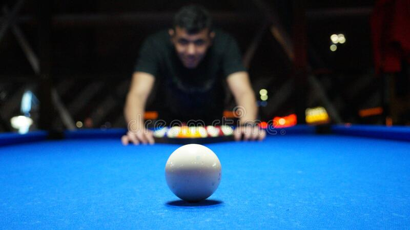 Man using a triangle to set up pool balls on blue baize table with white ball on foreground. & Free Public Domain CC0 Image: Man Setting Up Pool Balls Picture ...