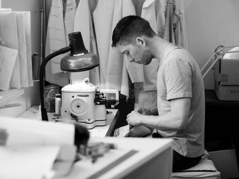 Man sews royalty free stock photos
