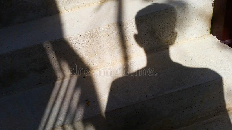 A man with a shadow stock photo