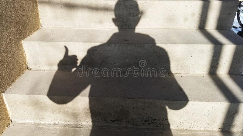 A man with a shadow royalty free stock images