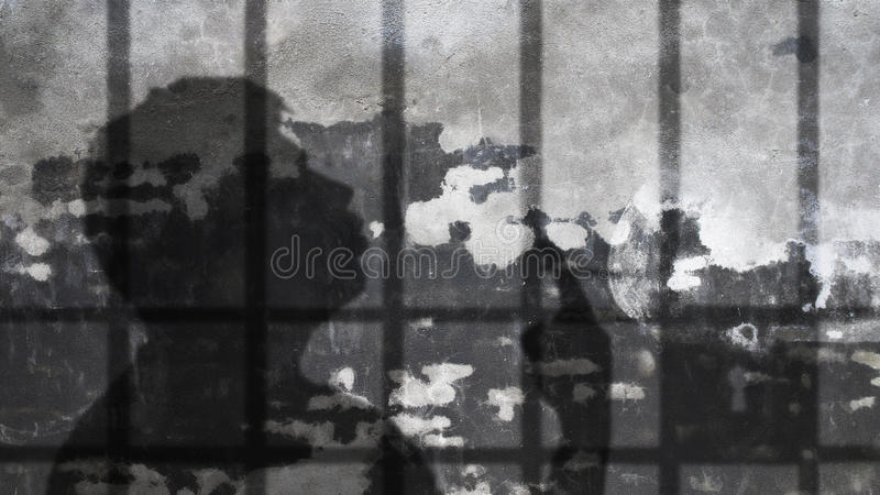 Man Shadow Smoking Under Jail Bars. Nicotine Dependence Metaphor stock photo