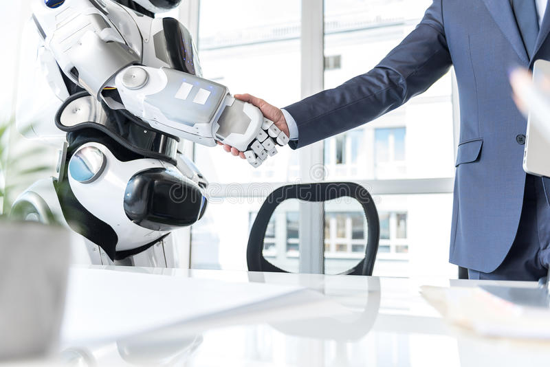 Man is shaking hand with cyborg royalty free stock image