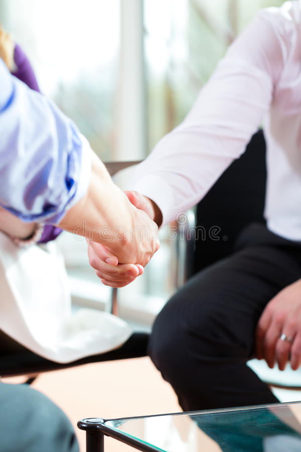 Man shaking hands with manager at job interview closeup cutout royalty free stock photos