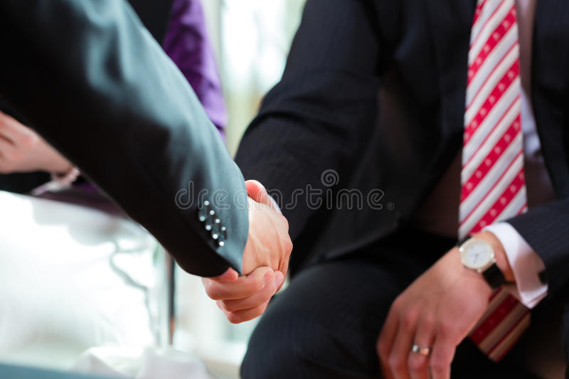 Man shaking hands with manager at job interview closeup cutout. Employment candidate hiring resume CEO work business stock photos
