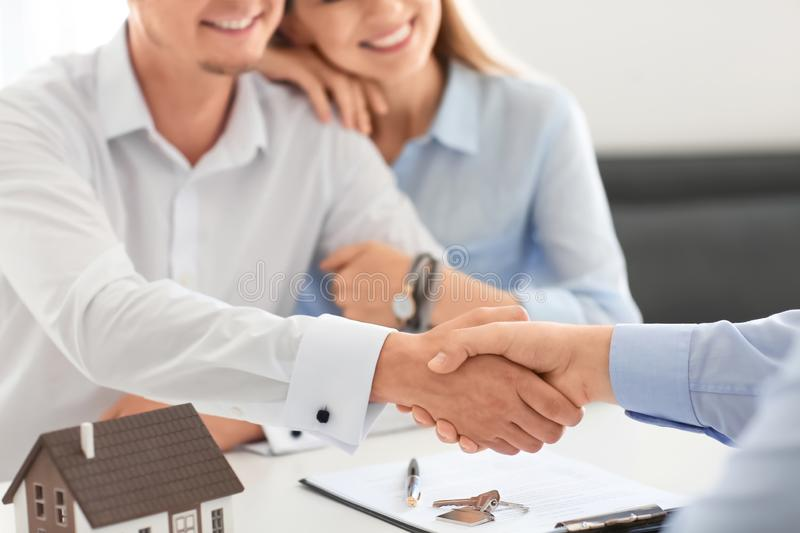 Man shaking hands with real estate agent in office stock photos