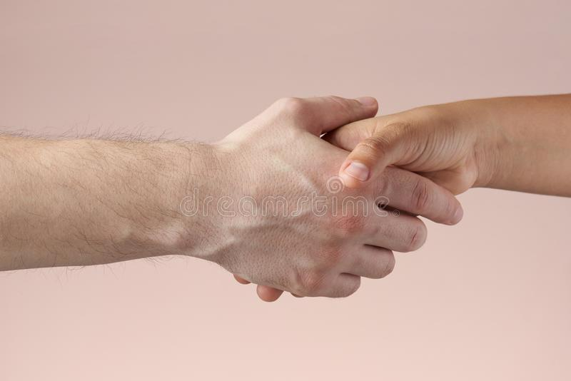 Man shaking woman`s hand stock photos