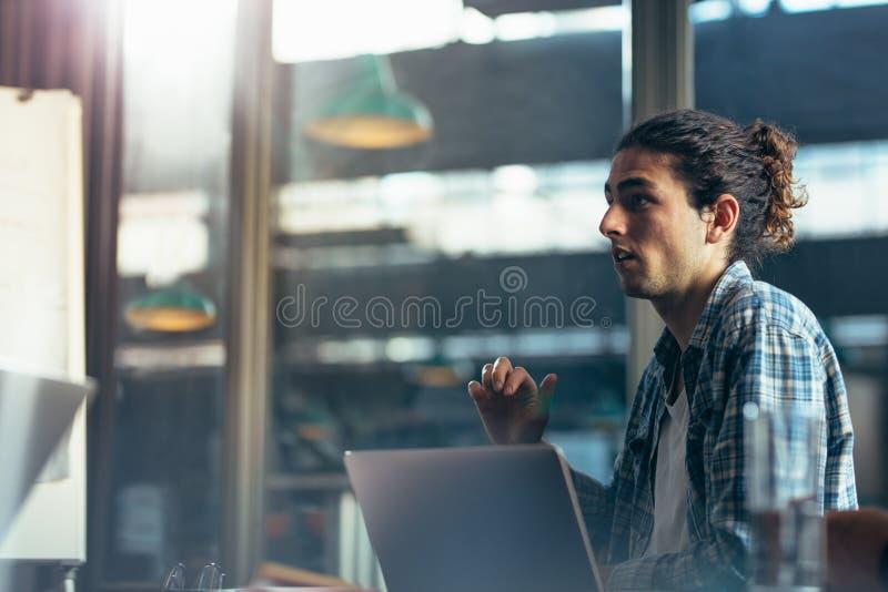 Man sharing his views in meeting royalty free stock image